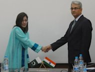 Indian defence official Shashikant Sharama (right) shakes hands with his Pakistani counterpart Nargis Saithi before start of talks at the Defence Ministry in Rawalpindi. Indian and Pakistani defence officials have held a fresh round of talks seeking to end decades of dispute over the Siachen Glacier, dubbed the world's highest battlefield