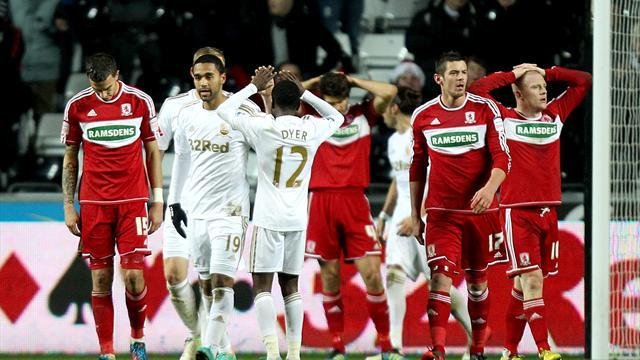 Football - Swans squeeze into last four