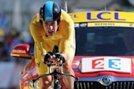 Britain's Bradley Wiggins, stage winner and overall leader's yellow jersey, at the end of the 41.5 km Tour de France solo race on July 9. Wiggins tightened his grip on the yellow jersey with a maiden Tour de France stage victory that heaped the pressure on defending champion Cadel Evans