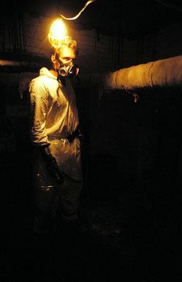 Josh Lucas as Hank exploring the dark tunnels of Danvers Mental Hospital in USA Films' Session 9