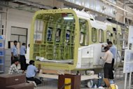 Indian technicians work in the Sikorsky S-92 helicopter cabin manufacturing facility at Tata Advanced Systems Limited (TASL) in Hyderabad, April 2012. India's factory sector picked up slightly in April, powered by new orders, but rising prices highlighted ongoing inflation risks, a business survey showed