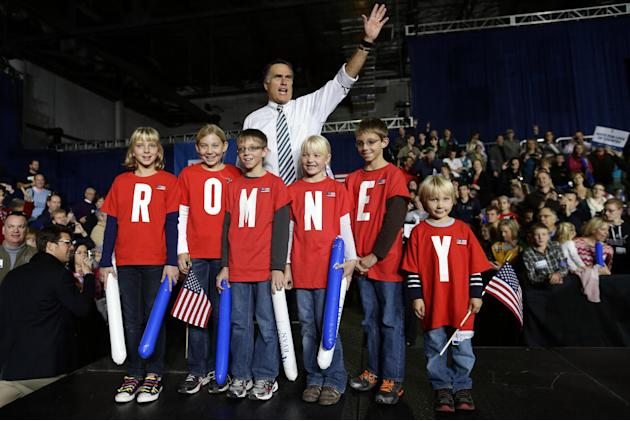 "Republican presidential candidate and former Massachusetts Gov. Mitt Romney poses with children wearing shirts which spell out ""Romney"" as he campaigns at the Iowa Events Center, in Des Moines, Sunday"