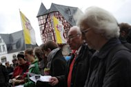 People demonstrate against the Bishop of Limburg on October 13, 2013 outside his lavish home in Limburg an der Lahn, western Germany