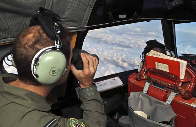 Aussie Air Force pilots scour the Indian Ocean for signs of debris from the missing MH370. (Reuters photo)