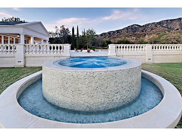One tycoon is selling two of America's priciest mansions bradbury hot tub