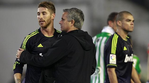 Real Madrid's coach Jose Mourinho (C) embraces player Sergio Ramos (L) (Reuters)