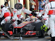 "McLaren-Mercedes driver Lewis Hamilton of Britain makes a pit stop during the Formula One Japanese Grand Prix at the Suzuka circuit in Suzuka, western Japan, October 7, 2012. Hamilton said a mysterious mid-race ""thud"" fixed his steering problems at the Japanese Grand Prix and kept his faint title hopes alive"