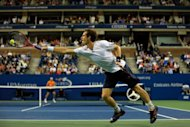 Andy Murray of Great Britain returns a shot to Milos Raonic of Canada during Day Eight of the 2012 US Open September 3, 2012 in New York City. Murray defeated Raonic 6-4, 6-4, 6-2