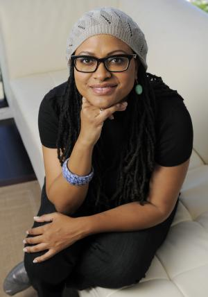"In this Wednesday, Oct. 17, 2012 photo, Ava DuVernay, writer/director of the film ""Middle of Nowhere,"" poses for a portrait in Los Angeles. Bringing light to untold stories and broadening the scope of black independent film is what moves DuVernay to distribute her own projects and those of other black filmmakers. (Photo by Chris Pizzello/Invision/AP)"