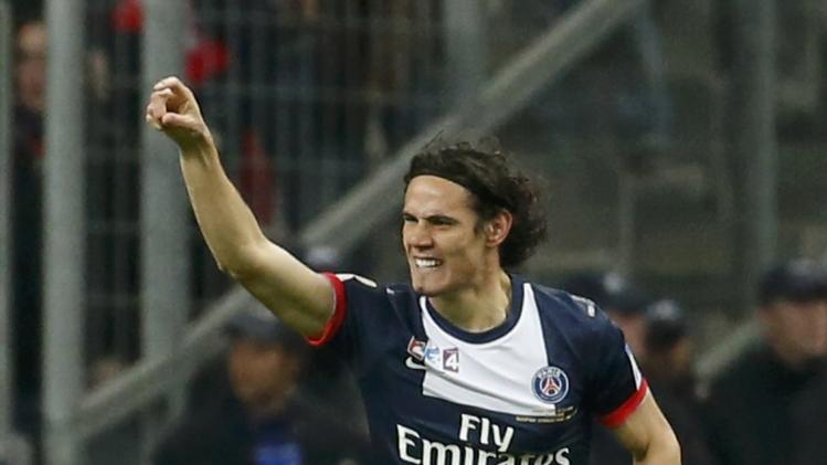 Paris St Germain's Paris St Germain's Edinson Cavani celebrates after scoring against Olympique Lyon during their French League Cup final soccer match at the Stade de France stadium in Saint-Denis