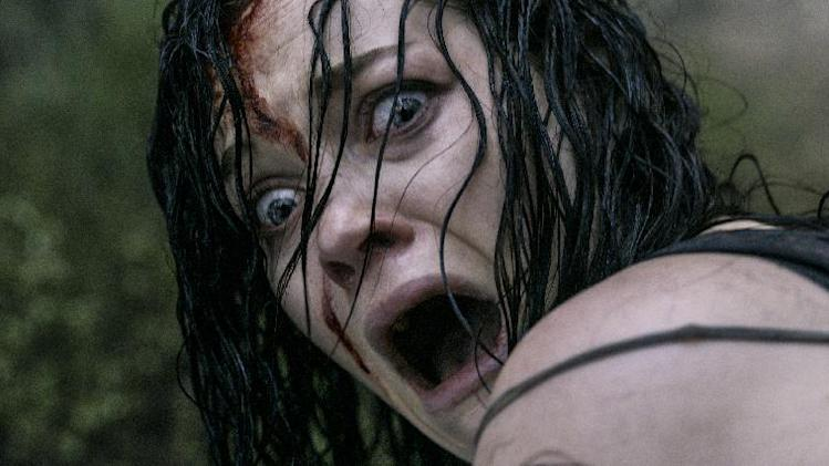 "This film image released by Sony-TriStar Pictures shows Jane Levy in a scene from ""Evil Dead."" (AP Photo/Sony-TriStar Pictures)"