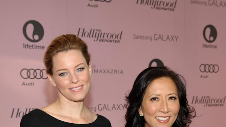 IMAGE DISTRIBUTED FOR THE HOLLYWOOD REPORTER - Actress Elizabeth Banks, left, and The Hollywood Reporter editorial director Janice Min arrive at The Hollywood Reporter's 21st Annual Women in Entertainment Power 100 breakfast presented by Lifetime on Wednesday, Dec. 5, 2012 in Beverly Hills, Calif.  (Photo by John Shearer/Invision for The Hollywood Reporter/AP Images)