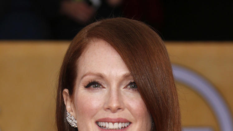 Julianne Moore arrives at the 19th Annual Screen Actors Guild Awards at the Shrine Auditorium in Los Angeles on Sunday Jan. 27, 2013. (Photo by Todd Williamson/Invision for The Hollywood Reporter/AP Images)