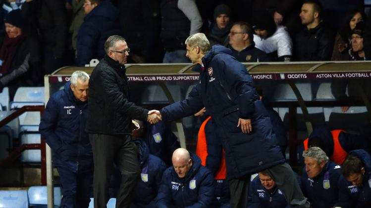 Aston Villa's manager Lambert shakes hands with his Arsenal counterpart Wenger following their English Premier League soccer match at Villa Park in Birmingham