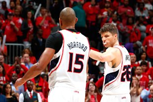 Al Horford and Kyle Korver celebrate a tough win. (Kevin C. Cox/Getty Images)