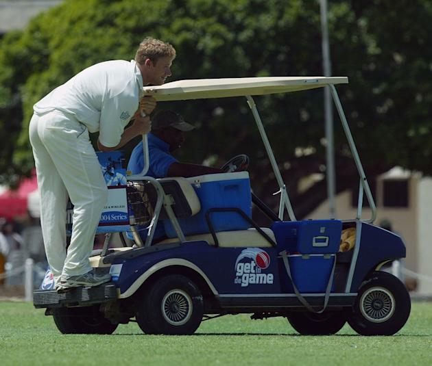 BRIDGTOWN, BARBADOS - MARCH 28:  Andrew Flintoff of England catches a ride on the drinks cart during the tour match between Carib Beer XI and England at the 3 W's Oval, University of West Indies, on M