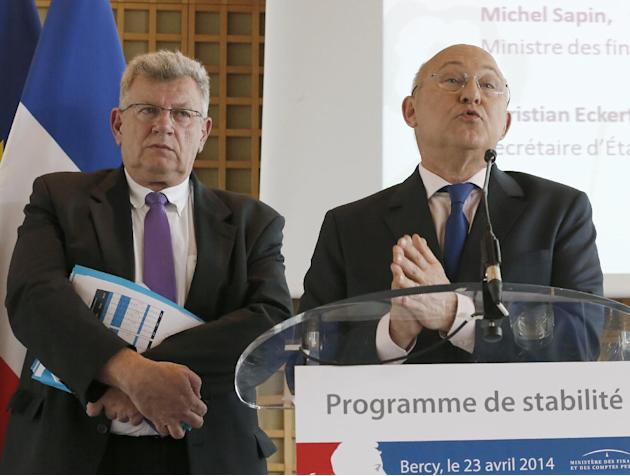 French Finance minister Michel Sapin, right, gestures as he gives a press conference alongside French junior Budget Minister Christian Eckert in Paris, Wednesday April 23, 2014. France aims to reduce