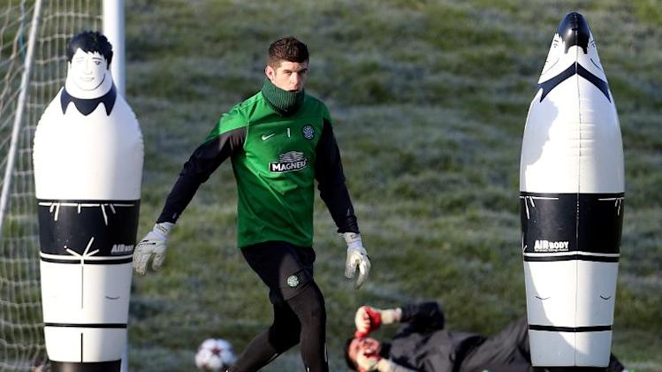Celtic goalkeeper Fraser Forster takes part in a training session at