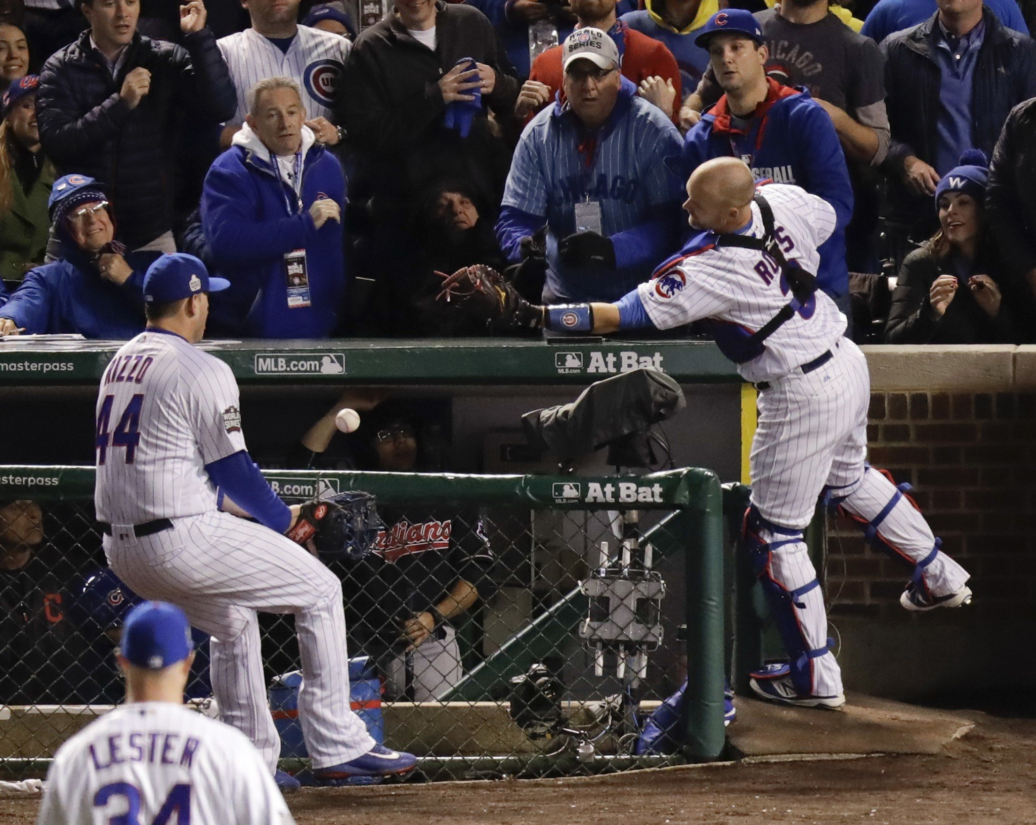 David Ross and Anthony Rizzo prove that two gloves are better than one. (AP)