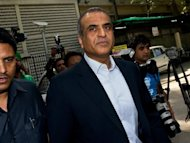 Chairman and Managing Director of Bharti Airtel Limited, Sunil Bharti Mittal leaves the Patiala House court in New Delhi on April 16, 2013. India's highest court has indefinitely postponed a hearing for Mittal over corruption allegations involving the allotment of telecom airwaves.