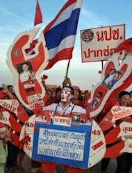 """Red Shirt"" supporters of Thailand's fugitive former premier Thaksin Shinawatra at a rally in Siem Reap province on Saturday. Thaksin told the rally: ""There are signs that I will be able to return home to stay with you."""