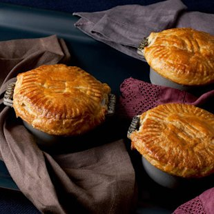 Chicken pies in cast iron dishes