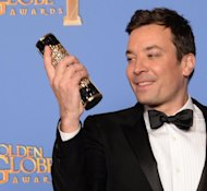 Jimmy Fallon poses in the press room during the 71st Annual Golden Globe Awards on January 12, 2014