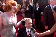 Christina Hendricks, left, with Make-A-Wish recipient David, center