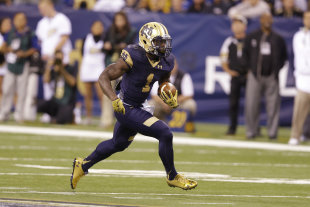In this Sept. 13, 2014, photo, Notre Dame running back Greg Bryant  runs against Purdue during the first half of an NCAA college football game in Indianapolis. While he is fourth on the team in carries, Bryant leads the eighth-ranked Irish in rushing with 119 yards, averaging 5.4 yards a carry. (AP Photo/Michael Conroy)