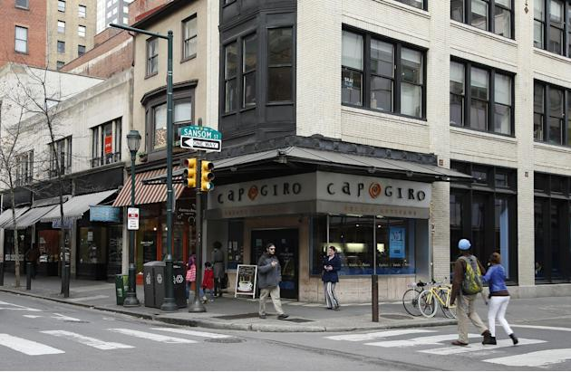 In this Tuesday, April 1, 2014 photo, pedestrians walk along 13th Street near Capogiro gelato in Philadelphia. Tourism officials will tell you the restaurant-rich area in the heart of downtown is call