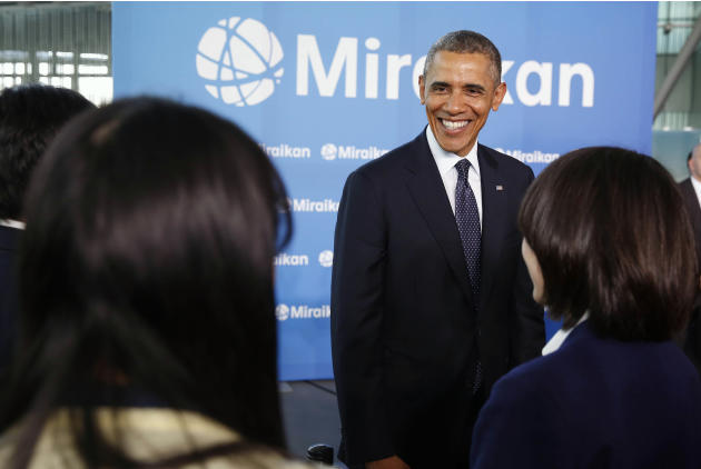 U.S. President Barack Obama talks to students while visiting Miraikan in Tokyo