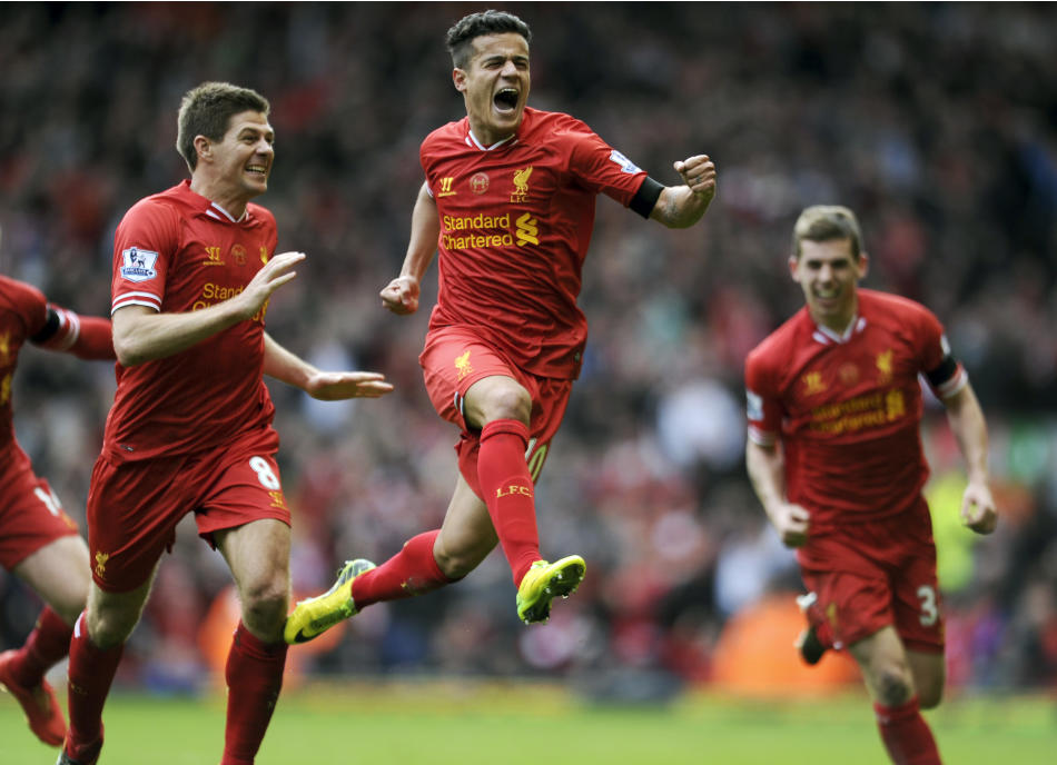 10ThingstoSeeSports - Liverpool's Philippe Coutinho, center, celebrates with teammate Steven Gerrard, left, after he scored the third goal of the game for his side during their English Premier Lea
