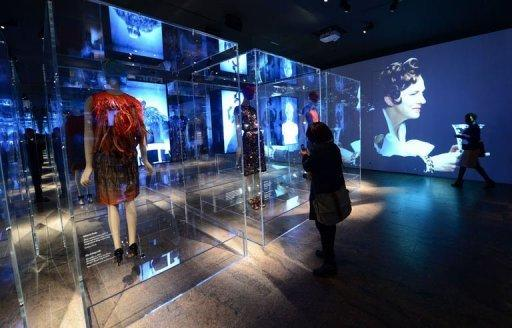 "Visitors look at the ""Schiaparelli and Prada: Impossible Conversations"" exhibition"