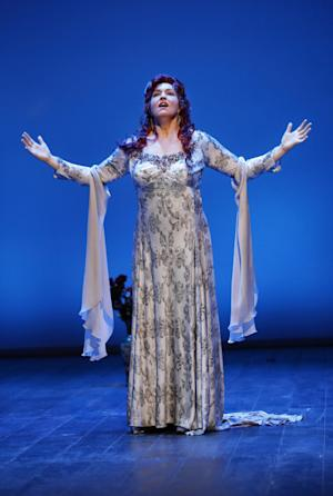 "In this Feb. 17, 2012 photo provided by the City Opera, Melody Moore performs as Regine Saint-Laurent during a dress rehearsal of Rufus Wainwright's ""Prima Donna"" at the Brooklyn Academy of Music, in Brooklyn, New York. (AP Photo/City Opera, Carol Rosegg)"
