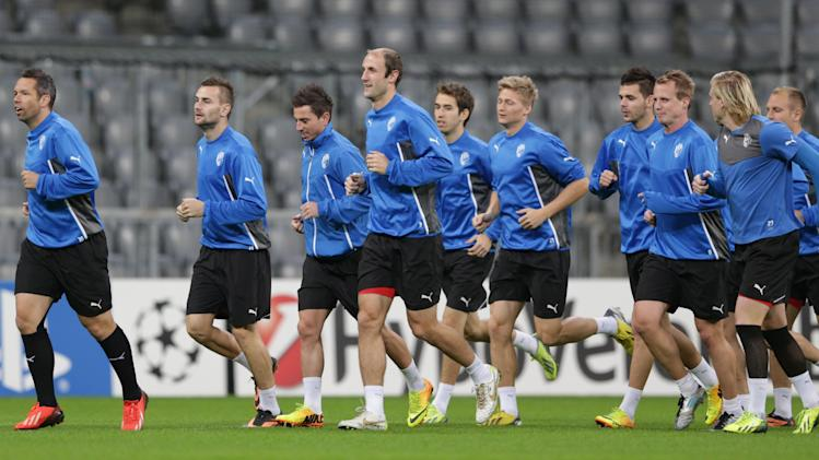 Plzen's team captain Pavel Horvath, left, leads his team during a training session in Munich, southern Germany, Tuesday, Oct. 22, 2013, ahead of the Champions League group D soccer match between FC Bayern Munich and Viktoria Plzen on Wednesday