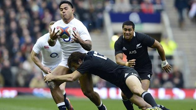 England's Manusamoa Tuilagi (L) is tackled by New Zealand's Conrad Smith during their international rugby union match at Twickenham