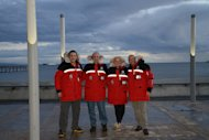 Diego Delgado, Dale Shippam, Heather Ross and Michel White smile in their Outdoor Survival Canada coats.
