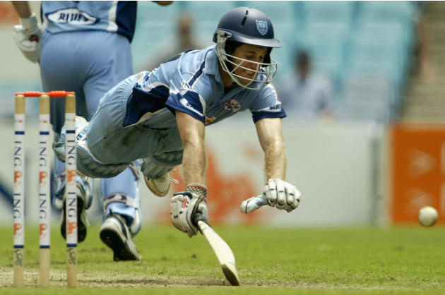 Simon Katich dives for the crease