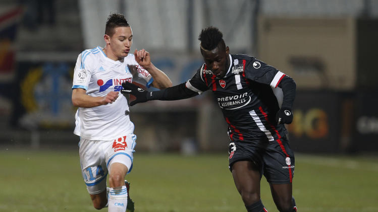 Olympique Marseille's Florian Thauvin challenges Valenciennes' Arthur Masuaku during their French Ligue 1 soccer match at the Velodrome Stadium in Marseille