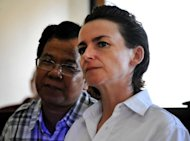Briton Rachel Dougall (R) appears in court for sentencing over drugs charges at a court in Denpasar, Bali on December 20, 2012. Dougall was sentenced to 12 months for failing to report Lindsay Sandiford's crime
