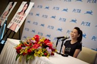 Taiwanese singer Annie Yi speaks to the media during a press conference in Beijing on March 8, 2012. Chinese authorities handed warnings to several celebrities who voiced support for a newspaper at the centre of a censorship battle online, newspaper reports said Friday