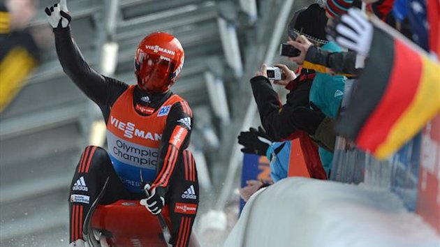 ermany's Felich Loch celebrates winning the European Luge championships in Oberhof
