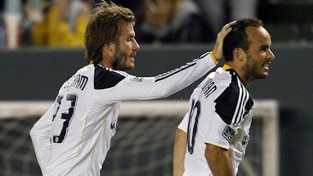 os Angeles Galaxy's David Beckham (L) celebrates with Landon Donovan (Reuters)