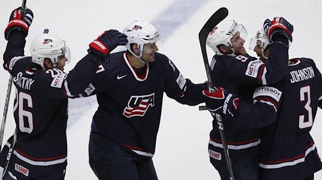 Paul Stastny of the U.S. celebrates with his teammates Max Pacioretty, Jack Johnson and Bobby Ryan