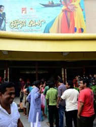 "Cinema goers gather at a movie theatre in Dhaka. A bold new film by the country's best known novelist and filmmaker is shedding light on historic ""Ghetu"" males who served as bed partners for rich Muslims"