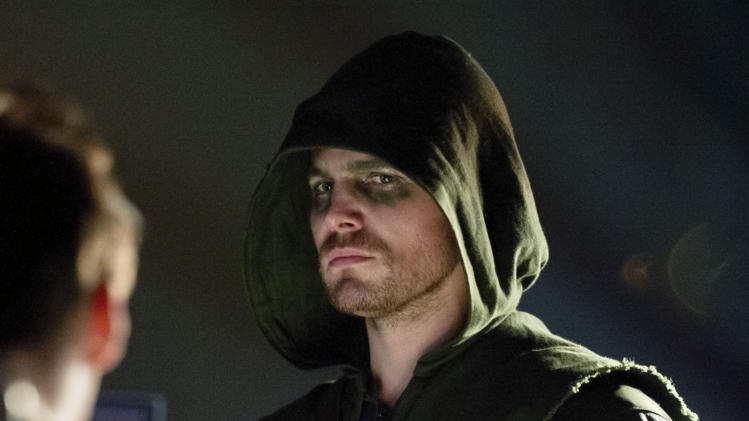 "This publicity image released by The CW shows Stephen Amell as Oliver Queen/Arrow in a scene from ""Arrow."" (AP Photo/The CW, Cate Cameron)"