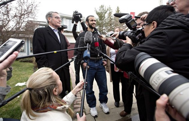 Omar Khadr speaks to media after being released on bail in Edmonton, Alta., on May 7, 2015. THE CANADIAN PRESS/Jason Franson