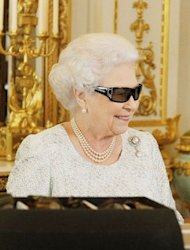 Queen Elizabeth II wears 3D glasses to watch the recording of her Christmas message to the Commonwealth which is to be broadcast in 3D for the first time, at Buckingham Palace in London on December 23, 2012. She will pay tribute to the London 2012 athletes in her annual Christmas message to the Commonwealth, saying they had inspired the world and drawn people in to the excitement and drama