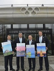 Members of the delegation of Istanbul (L to R) Ali Kiremitcioglu, CEO, IOC member and NOC President, Prof. Ugur Erdener, Major of Istanbul, Kadir Topbas and Bid Committee Leader, Hasan Arat, pose with the candidature files prior to the hand over on January 7, 2013 at the headquarters of the International Olympic Committee in Lausanne