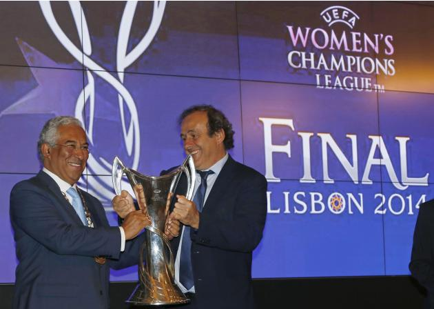 UEFA President Platini presents the UEFA Champions League Women's trophy to Lisbon Mayor Costa during a trophy handover ceremony in Lisbon
